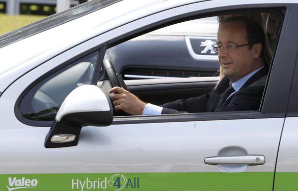 François Hollande en visite chez le constructeur automobile Valéo le 27 juillet 2012. – CHESNOT / SIPA