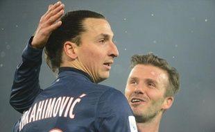 Les joueurs du PSG, Zlatan Ibrahimovic (à g.) et david Beckham, lors d'un match de L1 contre l'OM le 24 février 2013.