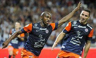 Camara et Herrera fêtent un but contre Toulouse, le 10 août 2012 au stade de la Mosson.