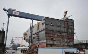 La décision sur une éventuelle mise en vente des chantiers navals STX France de Saint-Nazaire est attendue fin octobre ou courant novembre, affirme samedi le quotidien Le Figaro, citant une note confidentielle de Bercy.