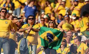 Des supporters brésiliens lors de la cérémonie d'ouverture à Sao Paulo, le 12 juin 2014.