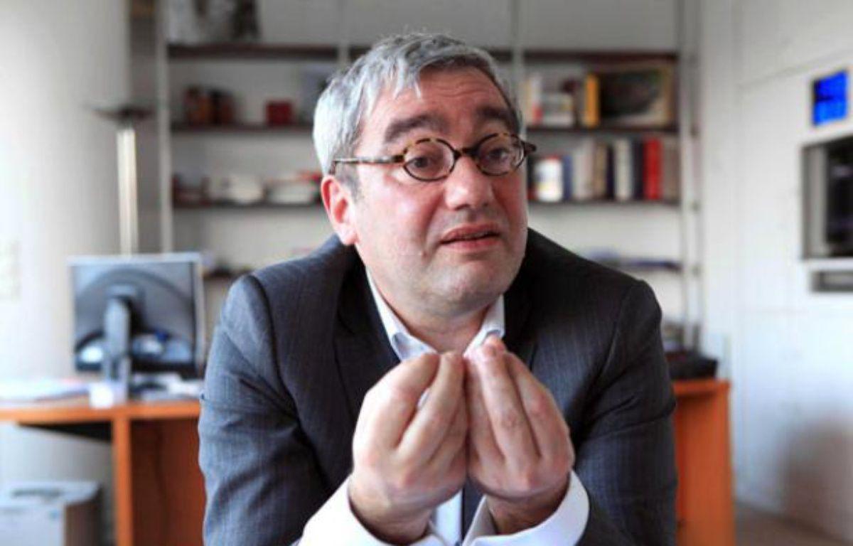 Emmanuel Hoog, PDG de l'AFP dans son bureau place de la Bourse, à Paris, le 14 mars 2011 – SIMON ISABELLE/SIPA