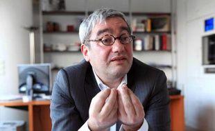 Emmanuel Hoog, PDG de l'AFP dans son bureau place de la Bourse, à Paris, le 14 mars 2011