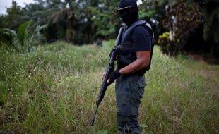 """Quatorze personnes ont été tuées vendredi dans l'assaut mené par les forces malaisiennes pour mettre fin à plus de deux semaines d'occupation d'une région de l'île de Bornéo par des Philippins membres d'un groupe armé revendiquant la zone au nom d'un """"sultanat""""."""