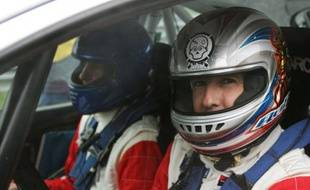 Le pilote de rallye français Didier Auriol (à dr.), lors d'un rallye à Monza, en Italie, le 26 novembre 2006.
