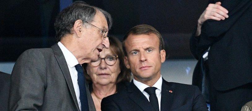 Denis Masseglia, le président du mouvemente olympique français, en discussion avec Emmanuel Macron lors d'un match au Stade de France, le 9 septembre 2018.