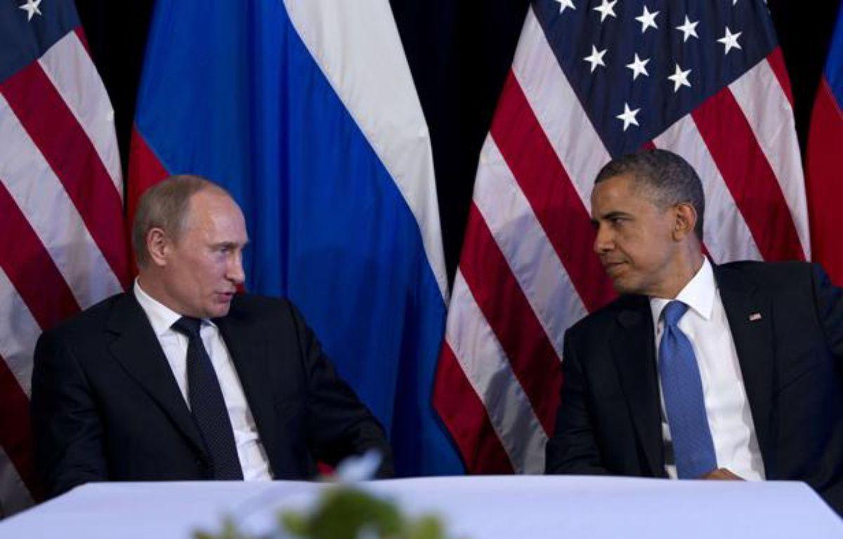 Le président russe Vladimir Poutine et son homologue américain Barack Obama lors d'une rencontre à Los Cabos (Mexique) le 18 juin 2012. – Carolyn Kaster/AP/SIPA