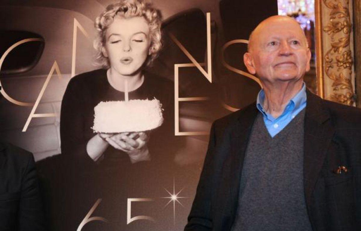 Le président du Festival de Cannes Gilles Jacob, qui accueille chaque soir les stars au sommet des marches avec le délégué général Thierry Frémaux, est arrivé pour la première fois sur la Croisette comme critique, en 1964. – FRANCK FIFE afp.com