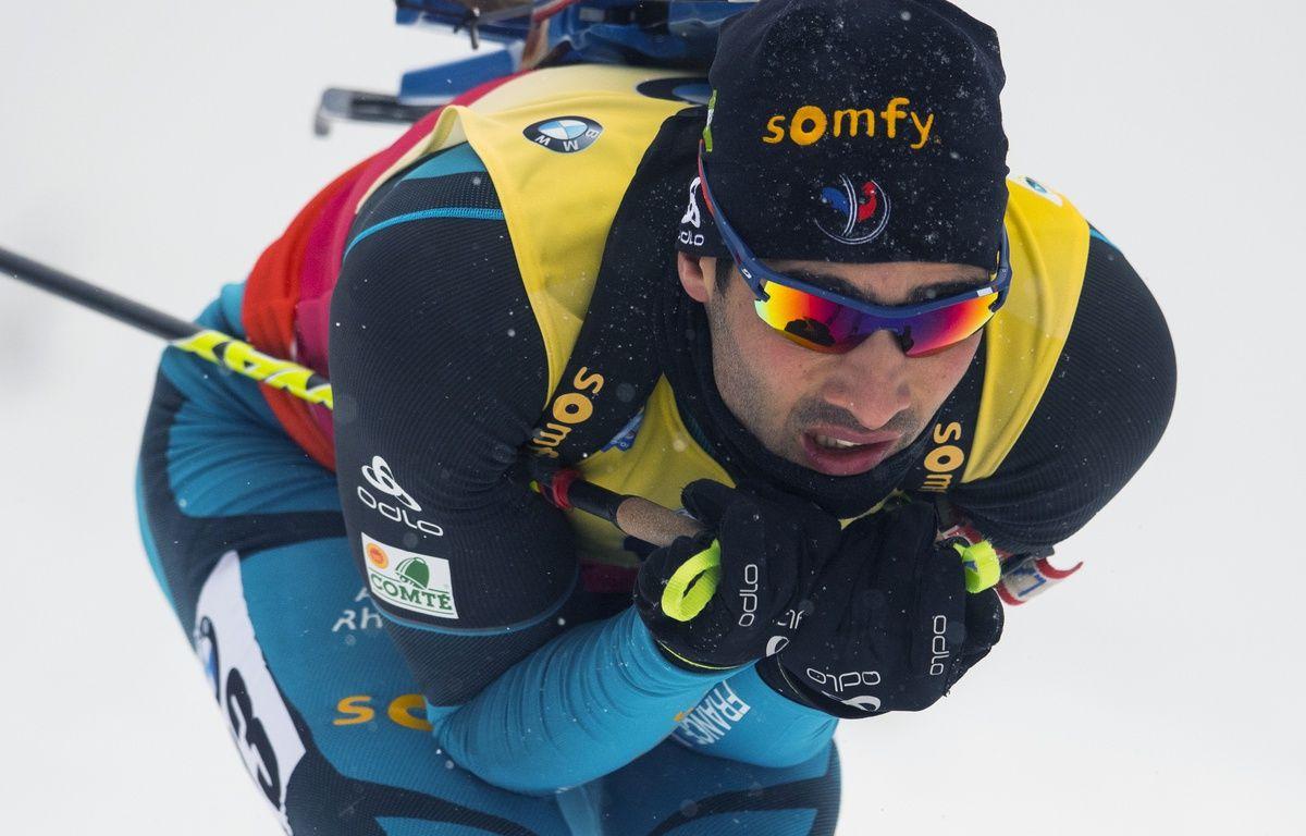 Martin Fourcade en pleine descente – ROBERT MICHAEL / AFP