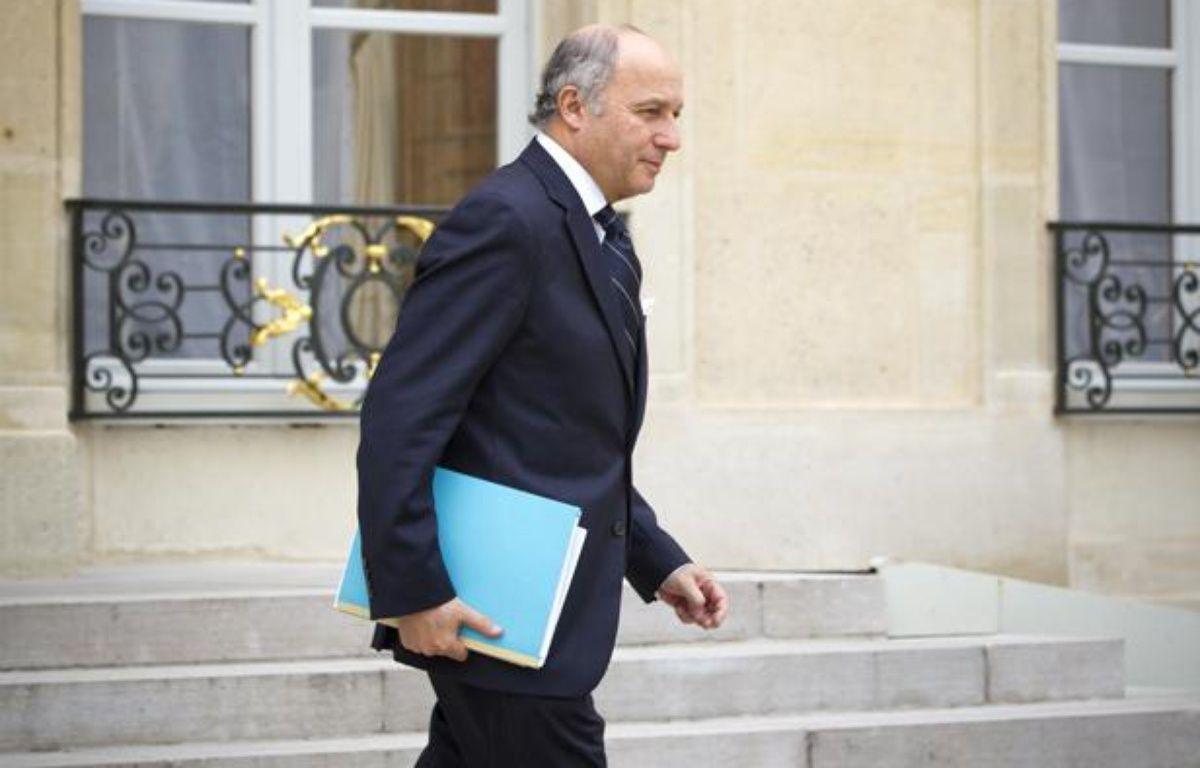 Laurent Fabius à la sortie d'un conseil des ministres le 6 mars 2013. – V. WARTNER / 20 MINUTES