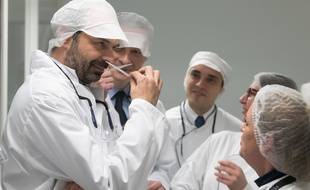 Edouard Philippe and Bruno le Maire smelling a parfum. French Prime Minister Edouard Philippe and French Economy Minister Bruno Le Maire visiting a factory of l'Oreal. Lassigny, FRANCE-16/02/2018