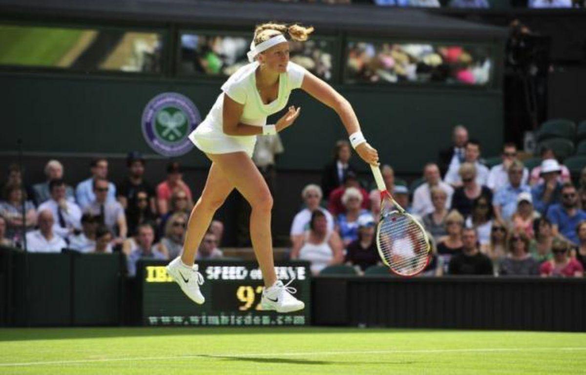 La Tchèque Petra Kvitova, tenante du titre, s'est qualifiée pour le deuxième tour de Wimbledon en battant l'Ouzbèke Akgul Amanmuradova en deux sets 6-4, 6-4 mardi. – Glyn Kirk afp.com