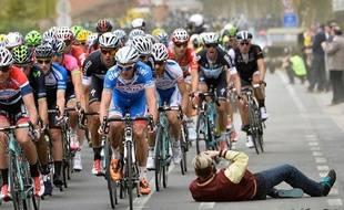 Le photographe inconscient lors de Gand-Wevelgem, le 30 mars 2013, en Belgique.