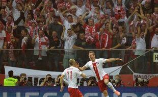 Les Polonais célèbrent leur victoire contre l'Allemagne, le 11 octobre 2014 à Varsovie.