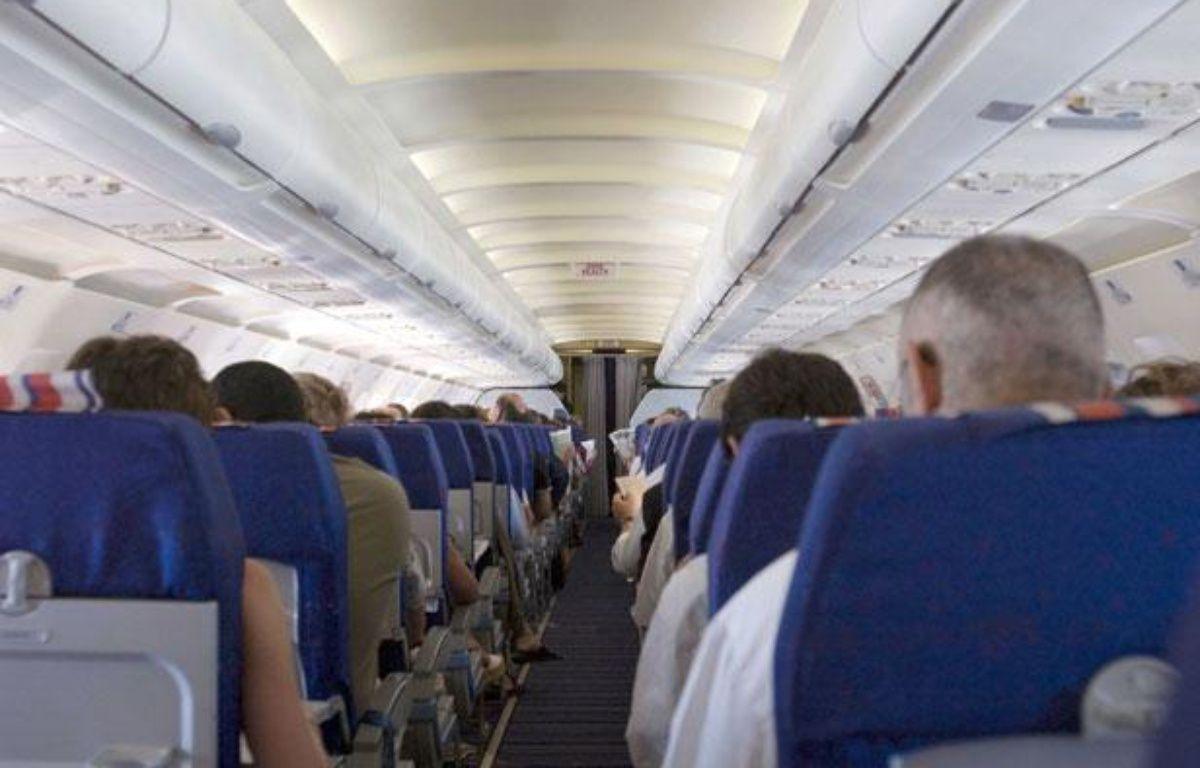 Des passagers à l'intérieur d'un avion de ligne – PIERANGELI/SIPA