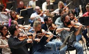 Musiciens du Philarmonique de Radio France en répétition, le 14 novembre 2014 à Paris