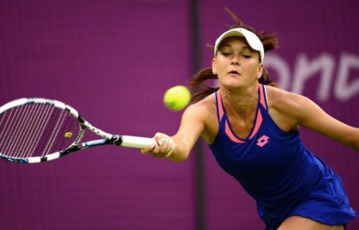 La Polonaise Agnieszka Radwanska, tête de série N.2, a été éliminée du tournoi de simple dames des jeux Olympiques 2012 dès son entrée en lice par l'Allemande Julia Görges, dimanche. – Martin Bernetti afp.com