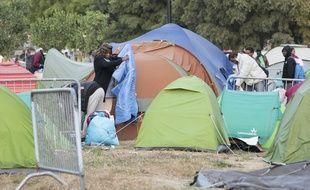 Des réfugiés lors de l'évacuation d'un camp à Nantes (Loire-Atlantique). Illustration