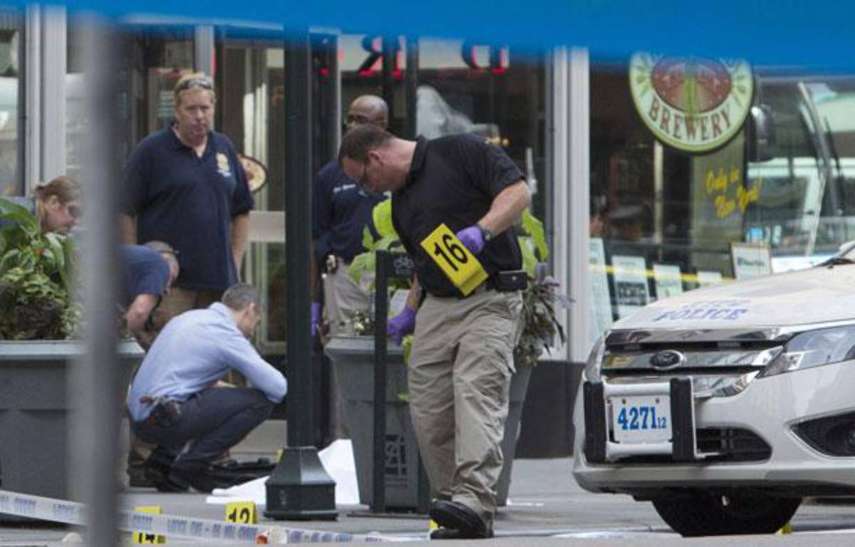 Des policiers sur la scène d'une fusillade intervenue à New York le 24 août 2012. – Andrew Kelly / GETTY IMAGES NORTH AMERICA / AFP