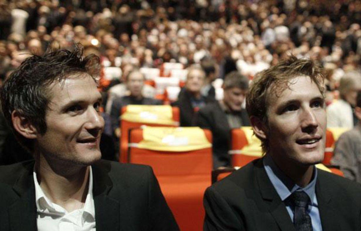 Franck et Andy Schleck, le 18 octobre 2011, au Palais des Congrès de Paris. – Laurent Cipriani/AP/SIPA