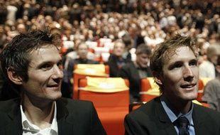 Franck et Andy Schleck, le 18 octobre 2011, au Palais des Congrès de Paris.