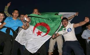 Algerian soccer fans cheer after tgeir team's World Cup victory over South Korea in Lille, North of France. Algeria won its first World Cup game in 32 years by defeating South Korea 4-2. Lille, FRANCE- 22/06/2014