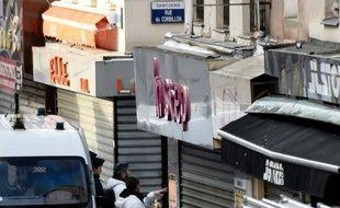 La police scientifique devant l'appartement de Saint-Denis visé par un assaut antiterroriste, le 18 novembre 2015