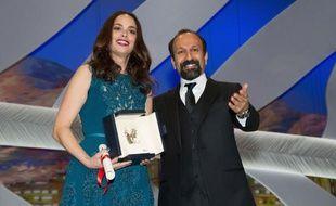 L'actrice franco-argentine Bérénice Bejo et le réalisateur iranien Asghar Farhadi, à Cannes, le 26 mai 2013. L'actrice avait reçu le prix d'interprétation féminine au festival de Cannes pour son rôle dans Le Passé.