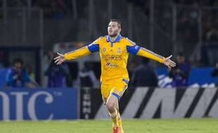 Tigres' Andre Gignac, celebrates after scoring against Pumas during the final match of the Mexican soccer league in Mexico City, Sunday, Dec. 13, 2015. (AP Photo/Eduardo Verdugo)/MXEV109/977902313289/1512140558