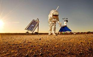Un membre de la Mars Society effectuant des mesures dans le désert du Sahara en 2013.