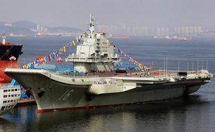 La Chine a annoncé mardi la mise au service actif de son premier porte-avions, dans un contexte de fortes tensions territoriales en mer de Chine orientale avec le Japon.