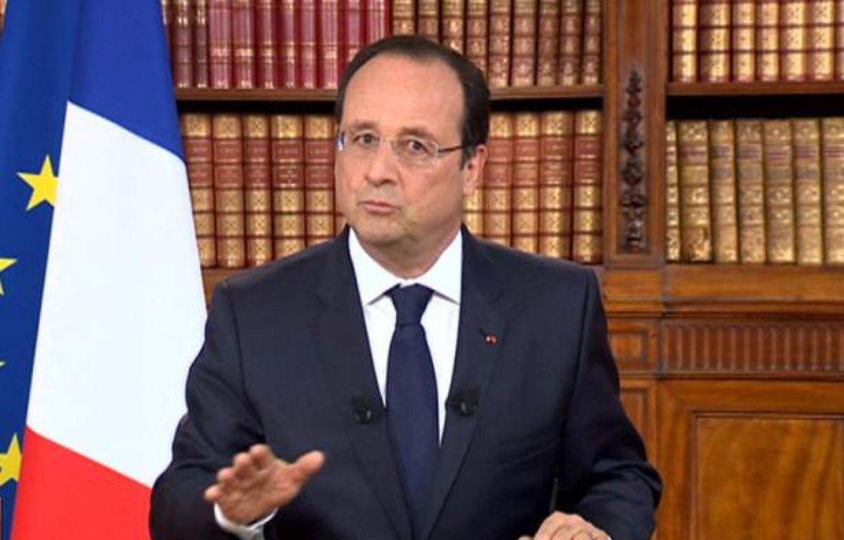 Capture d'écran - le président français Francois Hollande s'adressant à la nation sur les chaînes de télévision depuis l'Elysée, le 26 mai 2014, au lendemain des élections européennes – -- AFP