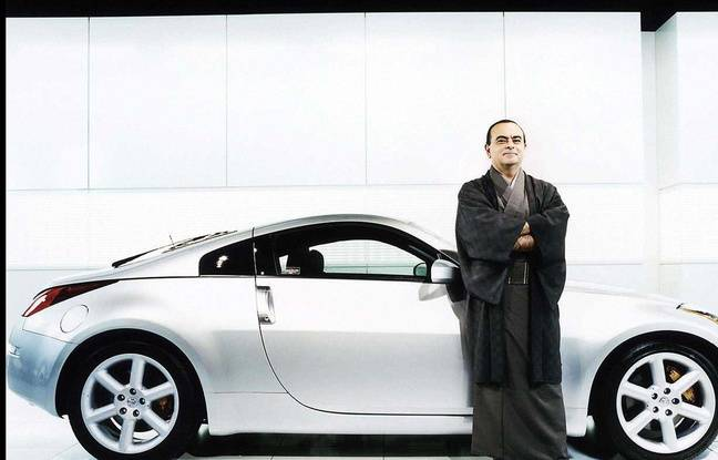 Carlos Ghosn poses in 2004 in front of a Nissan.