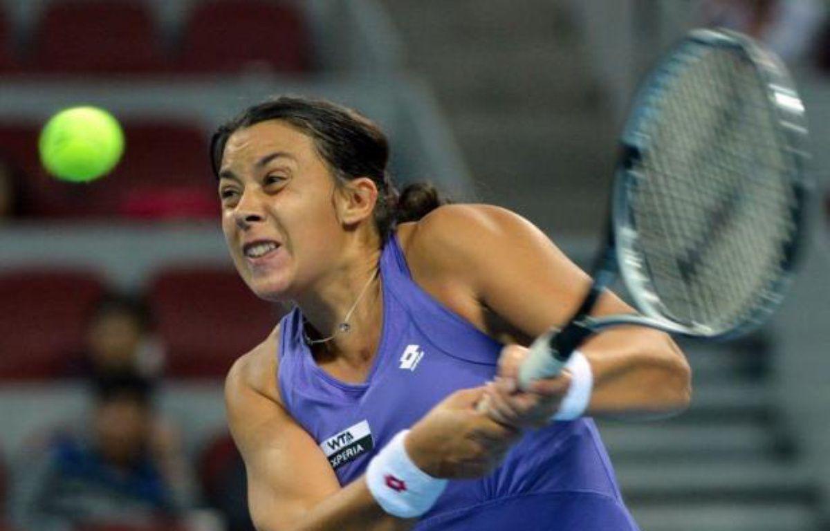 La Française Marion Bartoli, tête de série N.9 et 10e joueuse mondiale, s'est qualifiée mercredi pour les quarts de finale du tournoi WTA sur dur de Pékin, en battant au 3e tour l'Allemande Julia Georges, 21e mondiale, 6-3, 7-6 (7/2). – Mark Ralston afp.com