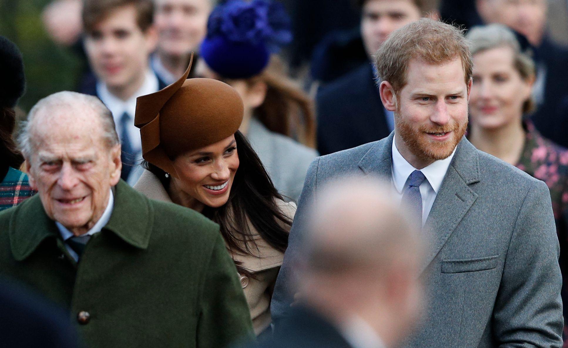 Le prince Philip (à gauche) et le prince Harry (à droite).