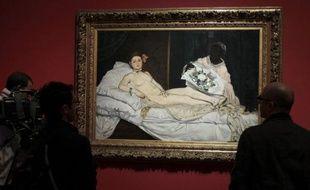 """La belle """"Olympia"""" va quitter Paris pour la première fois: le président François Hollande a donné son accord pour que ce nu d'Edouard Manet, qui a fait scandale en son temps, parte à Venise pour une exposition sur le peintre français."""