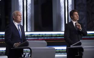 Le Premier ministre Justin Trudeau (à droite) et le conservateur modéré Erin O'Toole, lors d'un débat durant la campagne des législatives au Canada, le 8 septembre 2021.