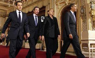 Nicolas Sarkozy, Anders Fogh Rasmussen, Angela Merkel et Barack Obama arrivent au dîner de travail de l'Otan à Baden-Baden, le 3 avril 2009.