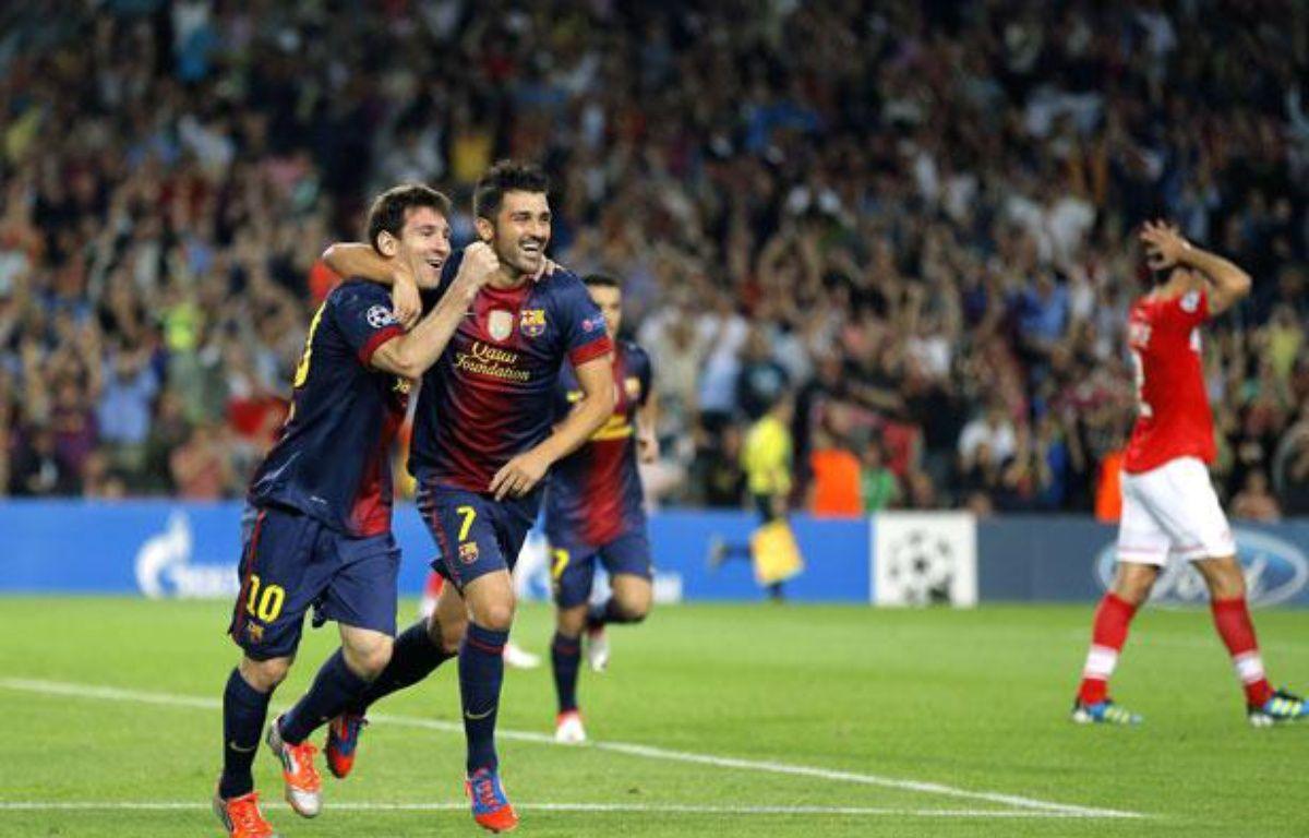 Lionel Messi et David Villa célèbrent un but de l'Argentin face au Spartak Moscou, le 19 septembre 2012 au Camp Nou. – Daniel Ochoa De Olza/AP/SIPA