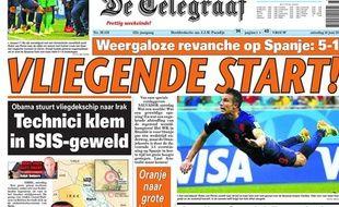 La presse néerlandaise célèbre la victoire des Pays-Bas contre l'Espagne, le 13 juin 2014, au Brésil.