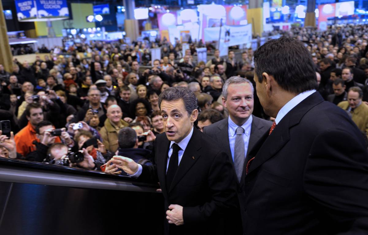 Nicolas Sarkozy, alors président de République et Bruno Le Maire, alors ministre de l'Agriculture, le 25 février 2012 au Salon de l'Agriculture à Paris. – AFP PHOTO / POOL / ERIC FEFERBERG