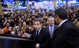 Nicolas Sarkozy, alors président de République et Bruno Le Maire, alors ministre de l'Agriculture, le 25 février 2012 au Salon de l'Agriculture à Paris.