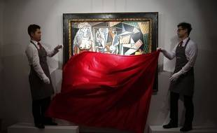 "Staff members from Christie's auction house unveil the painting ""Les Femmes d'Alger (Version ""O"")"" by painter Pablo Picasso during a media preview in Hong Kong Wednesday, April 1, 2015. The painting is expected to fetch US$140 million at the Christie's New York evening sale on May 11. (AP Photo/Kin Cheung)/XKC102/150064001990/1504011152"