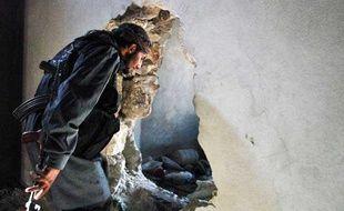 Un combattant syrien opposant au régime de Damas à Alep en Syrie.
