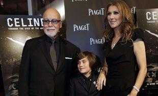 """Céline Dion, son mari René Angélil, et leur fils, René Charles, à leur arrivée à la première du film """"Céline: Through the Eyes of the World"""" à Miami Beach,le 16 février 2010."""