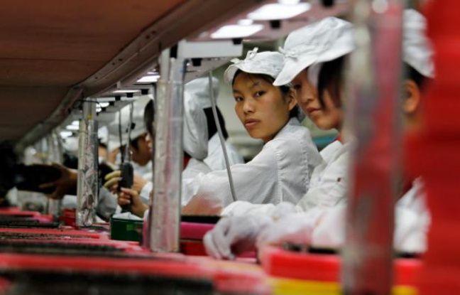 Des salariés chinois d'une usine Foxconn.