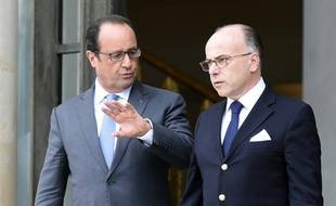 François Hollande et Bernard Cazeneuve, après une réunion sur la crise migratoire en Europe, le 3 septembre 2015 à l'Elysée à Paris