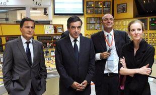 Eric Besson, François Fillon et Nathalie Kosciusko-Morizet en visite à la centrale nucléaire de Bugey (Ain), le 29 août 2011.