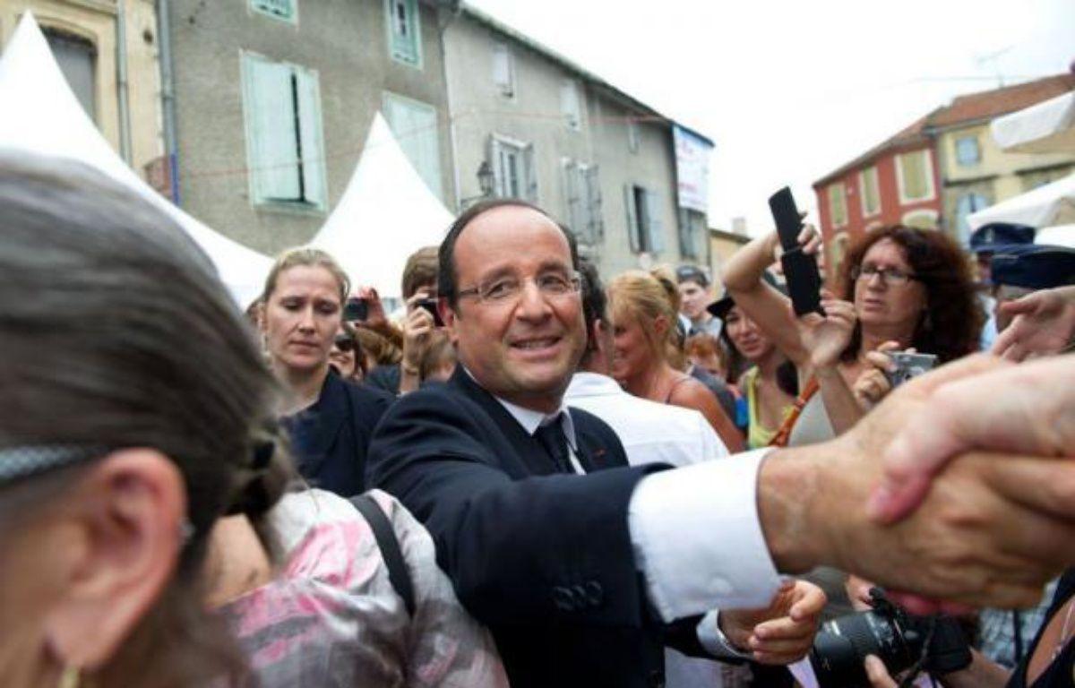 François Hollande a lancé un appel à une intervention rapide du Conseil de sécurité de l'ONU pour éviter de nouveaux massacres en Syrie, samedi lors d'une visite dans le Gers, où il a passé la journée entre défense du foie gras français et concert au festival de jazz de Marciac. – Bertrand Langlois afp.com
