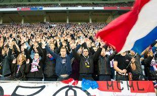 Lyon, le 9 janvier 2016. Des supporteurs dans les travées du Grand stade de l'OL. Crédit:KONRAD K./SIPA